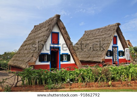 Madeira, the city of Santana. Pastoral landscape. Two charming rural houses with triangular thatched roof