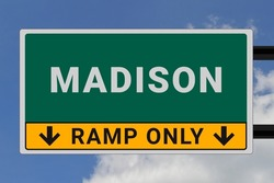 Madison logo. Madison lettering on a road sign. Signpost at entrance to Madison, USA. Green pointer in American style. Road sign in the United States of America. Sky in background