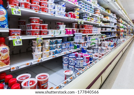 MADISON, NJ, USA - FEBRUARY 13, 2014: Cultured dairy products aisle in an American supermarket. Cultured milk products, known to mankind since antiquity, play an important role in the American diet.