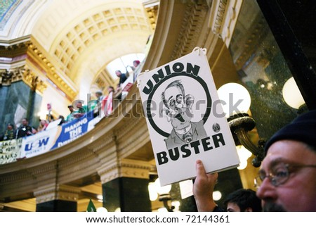 MADISON, WI - FEB 21: Thousands fill the capitol protesting Wisconsin Gov Scott Walker's proposal to eliminate collective bargaining rights for public workers on Feb 21, 2011 in Madison Wisconsin.