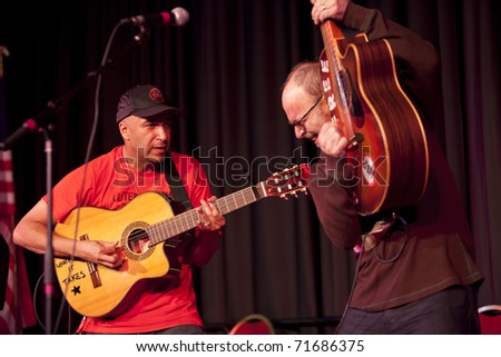 MADISON, WI - FEB. 21: Tom Morello (The Nightwatchman) and Wayne Kramer (MC5) perform at the Monona Terrace in Madison, WI on February 21, 2011 to rally for worker's rights in an anti-Walker protest.