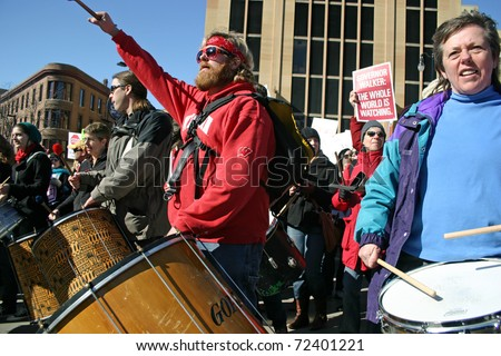 MADISON, WI - FEB 19: Unidentified people protest WI Budget Repair Bill on February 19, 2011 on the capitol square in Madison, WI.  The drummers lead many people marching in protest of the bill.