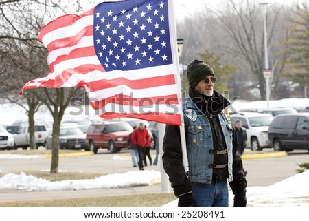 Madison, WI-February 17:Members of the Patriot Guard Riders motorcycle club demonstrate before the 32nd IBCT sendoff ceremony on Feb 17, 2009. Madison, WI.