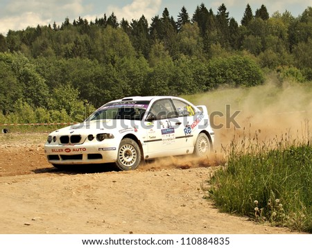 MADONA, LATVIA-JUNE 9:Ago Ahu and Kalle Ahu drives BMW M3 during a motoring event Rally Madona 2012 in Madona, Latvia on June 09, 2012.