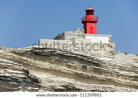 Madonetta lighthouse on limestone cliff, Corsica island, France