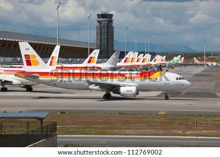 MADRID - APRIL 24: An Iberia Airbus A320 taxis in front of Terminal 4 on April 24, 2011 in Madrid. Iberia is the largest spanish airline with some 104 planes and 24 million passengers in 2010.