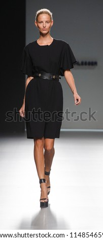 MADRID -Â?Â? AUGUST 31: A model walks on the Angel Schlesser catwalk during the Cibeles Madrid Fashion Week runway on August 31, 2012 in Madrid, Spain.