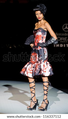 MADRID - AUGUST 31: A model walks on the Roberto Verino catwalk during the Cibeles Madrid Fashion Week runway on August 31, 2012 in Madrid.