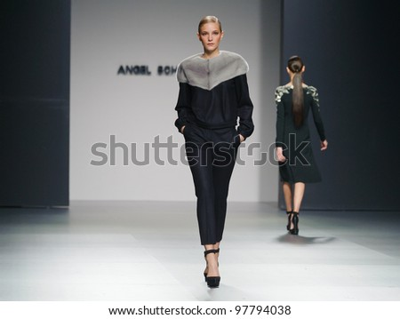 MADRID  FEBRUARY 02: A model walks on the Angel Schlesser catwalk during the Mercedes-Benz Fashion Week Madrid runway on February 02, 2012 in Madrid, Spain.