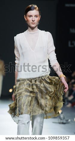 MADRID - FEBRUARY 01: A model walks on the Duyos catwalk during the Mercedes-Benz Fashion Week Madrid runway on February 01, 2012 in Madrid, Spain.