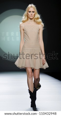 MADRID - FEBRUARY 03: A model walks on the Teresa Helbig catwalk during the Mercedes-Benz Fashion Week Madrid runway on February 03, 2012 in Madrid, Spain.
