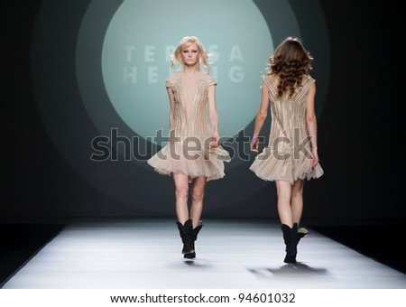 MADRID – FEBRUARY 03: A model walks on the Teresa Helbig catwalk during the Mercedes-Benz Fashion Week Madrid runway on February 03, 2012 in Madrid, Spain. - stock photo