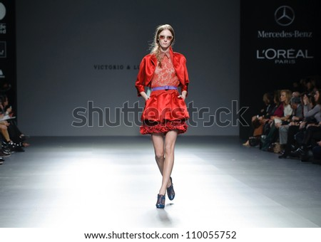 MADRID - FEBRUARY 01: A model walks on the Victorio & Lucchino catwalk during the Mercedes-Benz Fashion Week Madrid runway on February 01, 2012 in Madrid, Spain.