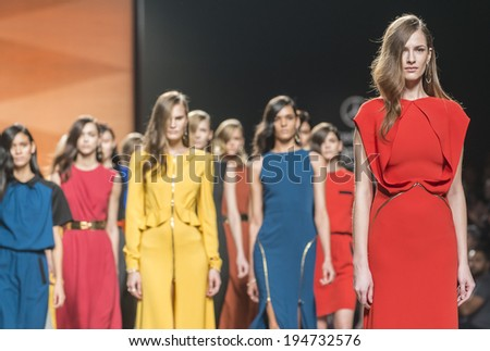 MADRID FEBRUARY 17 models walking on the Juanjo Oliva catwalk during the Mercedes-Benz Fashion Week Madrid Fall Winter 2014-2015 runway on February 17 2014 in Madrid