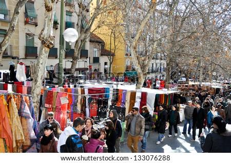 MADRID - FEBRUARY 3: Scene from El Rastro flea market on February 3, 2013 in Madrid, Spain. El Rastro is held in La Latina neighborhood every Sunday ant its the most important market in Madrid.