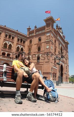 Madrid. Happy couple travelling in Spain, in front of the bullfighting arena Plaza de Toros de Las Ventas in Madrid.