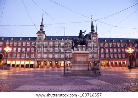 MADRID - JANUARY 24: Statue of Felipe III at Plaza Mayor in Madrid on January 24, 2011. Seen morning time with the old Plaza Mayor buildings. The statue was erected in 1616.