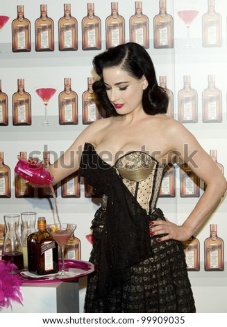 MADRID - MAY 27: Dita Von Teese attends the presentation of the new Cointreau cocktail at the ME Hotel on May 27, 2010 in Madrid #99909035