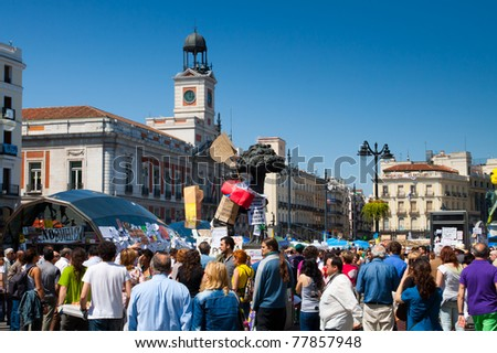 MADRID - MAY 15: Thousands gather to protest for economic equality during the Spanish Revolution days in Puerta del Sol Square in Madrid, Spain on May 15, 2011.