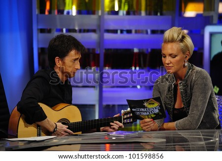 MADRID - MAY 20: TV host Pablo Motos and singer Kate Ryan sing together at the Spanish TV show \
