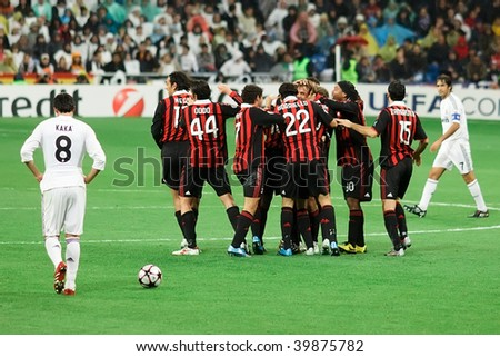 MADRID - OCT 21: A dejected Madrid and former AC Milan midfielder Kaka walks by Milan players celebrating the first goal of Milan's 3-2 victory over Real Madrid Oct. 21, 2009 in Madrid, Spain.