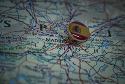 Madrid pinned on a geographical map with flag of Spain