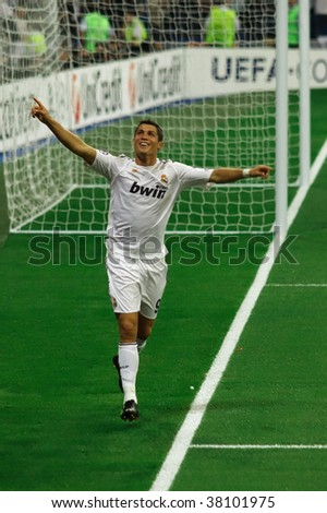 MADRID - SEPT 30 : Cristiano Ronaldo celebrates the third goal during Real Madrid's 3-0 victory over Olympique Marseille in Champions League group stage action September 30, 2009 in Madrid - stock photo