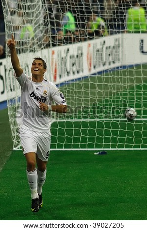 MADRID - SEPT 30: Cristiano Ronaldo celebrates the third goal of Real Madrid's 3-0 victory over Olympique Marseille in Champions League group stage action September 30, 2009 in Madrid.
