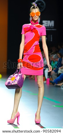 MADRID – SEPTEMBER 17: A model walks on the Agatha Ruiz de la Prada catwalk during the Cibeles Madrid Fashion Week runway on September 17, 2011 in Madrid, Spain.