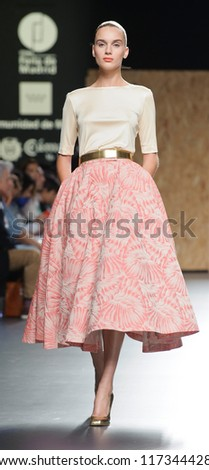 MADRID - SEPTEMBER 01: A model walks on the Duyos catwalk during the Cibeles Madrid Fashion Week runway on September 01, 2012 in Madrid.