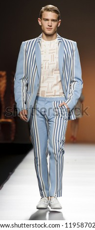 MADRID - SEPTEMBER 02: A model walks on the Ion Fiz catwalk during the Cibeles Madrid Fashion Week runway on September 02, 2012 in Madrid.