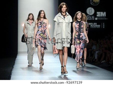 MADRID SEPTEMBER 16 Models walking on the Adolfo Dominguez catwalk during the Cibeles Madrid Fashion Week runway on September 16 2011 in Madrid Spain..
