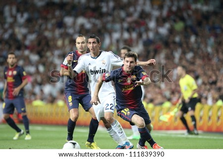 MADRID, SPAIN - AUGUST 29: Leo Messi fights for the ball with Angel Di Maria during the Supercopa, Real Madrid vs FC Barcelona, on August 29, 2012 at the Santiago Bernabeu Stadium.