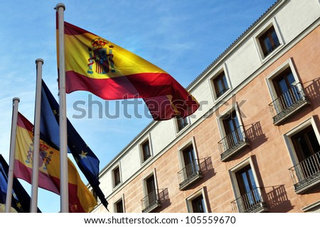 Madrid, Spain cityscape. Spanish flags wave in Madrid city, Spain.