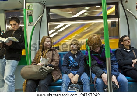MADRID, SPAIN-DEC 20: people travel by metro to center on December 20,2010 in Madrid, Spain. Madrid runs the third largest underground train network in europe, and the sixth largest  in the world.