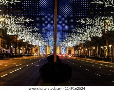 Madrid, Spain - December 2017:  Christmas lights on downtown street #1149162524
