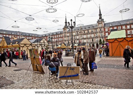 MADRID, SPAIN - DECEMBER 12: Painters offer their art at Madrids Plaza de major in Christmas time on December 12, 2010 in Madrid, Spain. The square was inaugurated in 1620 by Felipe III.