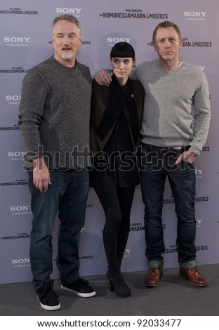 MADRID, SPAIN - JANUARY 04: Actor Daniel Craig, actress Rooney Mara and director David Fincher present 'The Girl With The Dragon Tattoo' at Villamagna hotel on January 4, 2012 in Madrid, Spain.