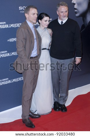 MADRID, SPAIN - JANUARY 04: Actor Daniel Craig, actress Rooney Mara and director David Fincher attend 'The Girl With The Dragon Tattoo' premiere at Callao cinema on January 4, 2012 in Madrid, Spain.