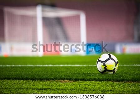 MADRID, SPAIN, JANUARY. 3. 2018: Football concept photo - Ball, stadium, grass and football net #1306576036