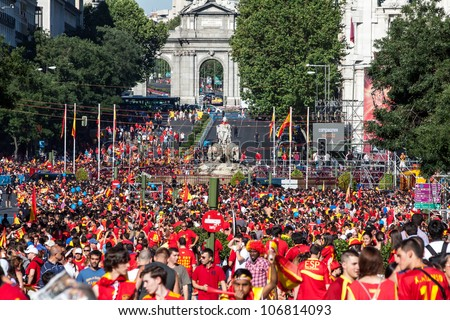 MADRID, SPAIN - JULY 2: Spanish fans celebrate in the Plaza de Cibeles in the victory of the Spanish football at Euro 2012 held in Poland and Ukraine. in Madrid, Spain, July 2, 2012