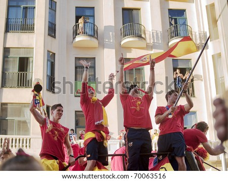 MADRID, SPAIN - JULY 12: Spanish soccer selection team celebrates the won World Cup of South Africa 2010 on July 12, 2010 at Madrid. Players Torres, Ramos and Reina with the cup the day after succes.