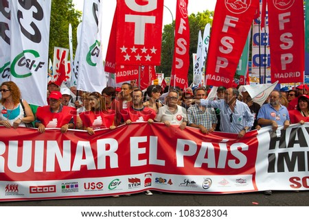 MADRID, SPAIN - JULY 19: Thousands of people are evident in the streets to protest cuts in public services, in the squares Neptune, Cibeles and Puerta del Sol in Madrid, Spain on July 19, 2012.