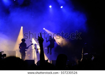 MADRID, SPAIN - JUNE 23: Silhouette of Paul Smith, singer of Maximo Park (band), jumping during his concert at Matadero de Madrid on June 23, 2012 in Madrid, Spain. Dia de la Musica Festival.