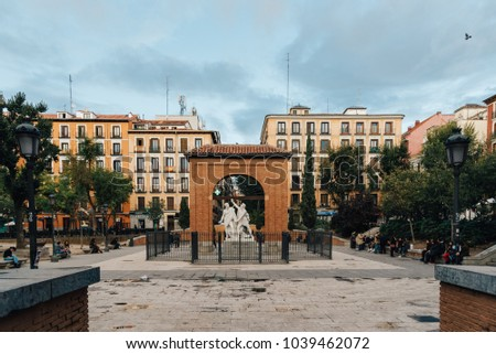 Madrid, Spain - November 3, 2017: Dos de Mayo Square in Malasaña district in Madrid. Malasaña is one of the trendiest neighborhoods in Madrid, well known for its counter-cultural scene #1039462072