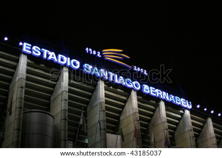 MADRID, SPAIN - NOVEMBER 21: Santiago Bernabeu, the lighting shield of the stadium before football match Real Madrid - Racing Santander on November 21, 2009 in Madrid, Spain - stock photo