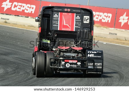 MADRID, SPAIN - OCT 10 : Hungarian driver Norbert Kiss in a MAN truck races in the XXIV GP of Spain during the the 2011 FIA Truck Racing season, on Oct 10, 2011 in Madrid, Spain.