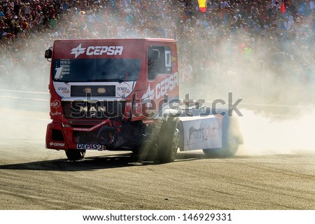 MADRID, SPAIN - OCT 10 : Spanish driver Antonio Albacete in a MAN Truck races in the XXIV GP of Spain during the the 2011 FIA Truck Racing season, on Oct 10, 2011 in Madrid, Spain.