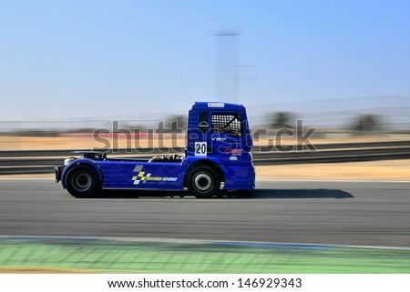 MADRID, SPAIN - OCT 10 : Spanish driver Javier Mariezkurrena in a MAN truck races in the XXIV GP of Spain during the the 2011 FIA Truck Racing season, on Oct 10, 2011 in Madrid, Spain.
