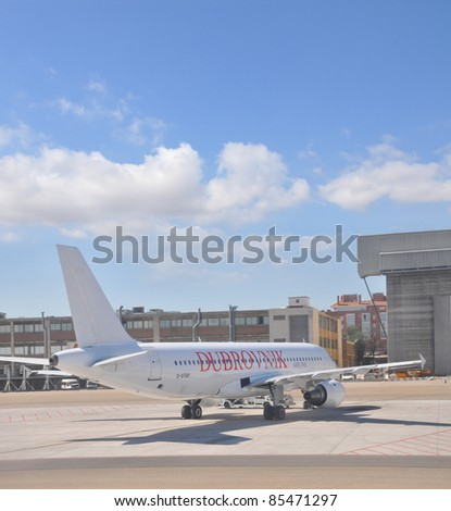 MADRID, SPAIN - SEPT 15: Dubrovnik Airline Ltd. airplane lands at Madrid Barajas Airport on Sept. 15, 2011 in Madrid, Spain. Dubrovnik, founded in 2004, is a charter airline that carries more than 300,000 passengers yearly.